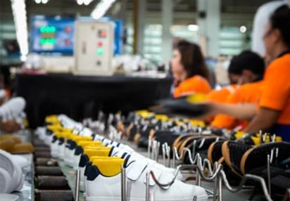 https://www.sourcingwise.com/wp-content/uploads/2021/10/shoes-production.png